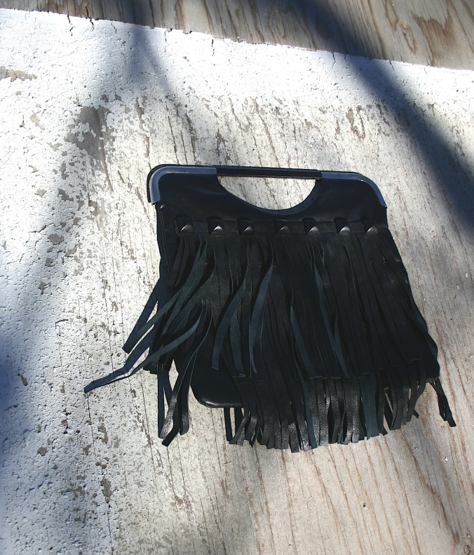 bag with studs and fringes