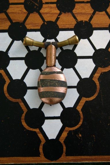 diy stone pendant with copper colored stripes