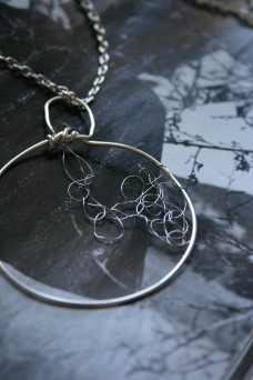 round silver pendant with wire