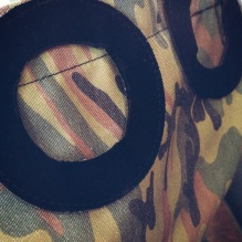 suede ring decorating camo bag