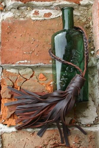 diy brown leather tassel with old bottle