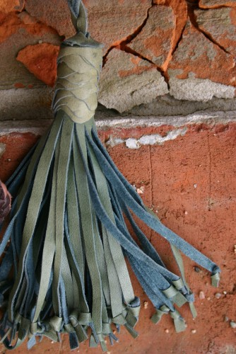 green leather tassel