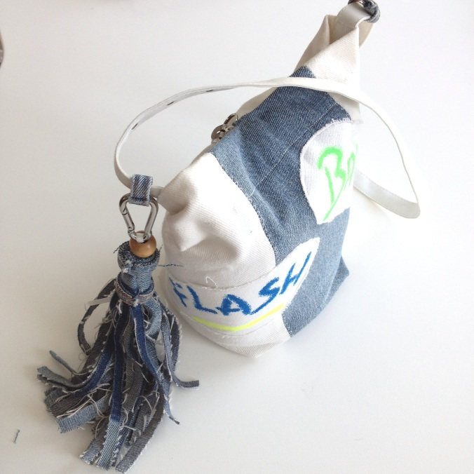 diy camera bag out of 90`s print fabric and denim tassel