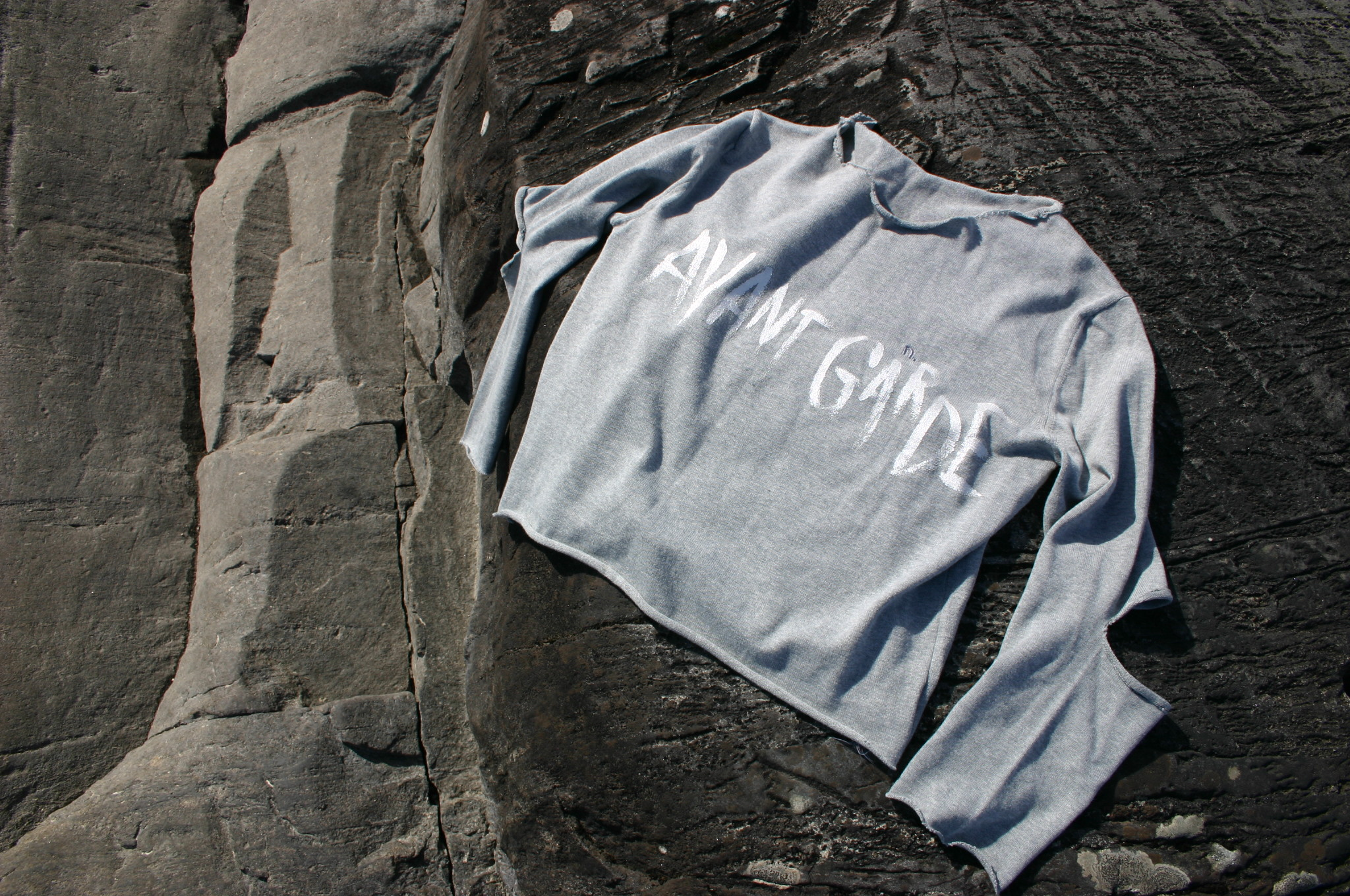 diy free hand lettering with silver paint on jumper