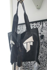 diy leather bag out of old jacket with white leather deco
