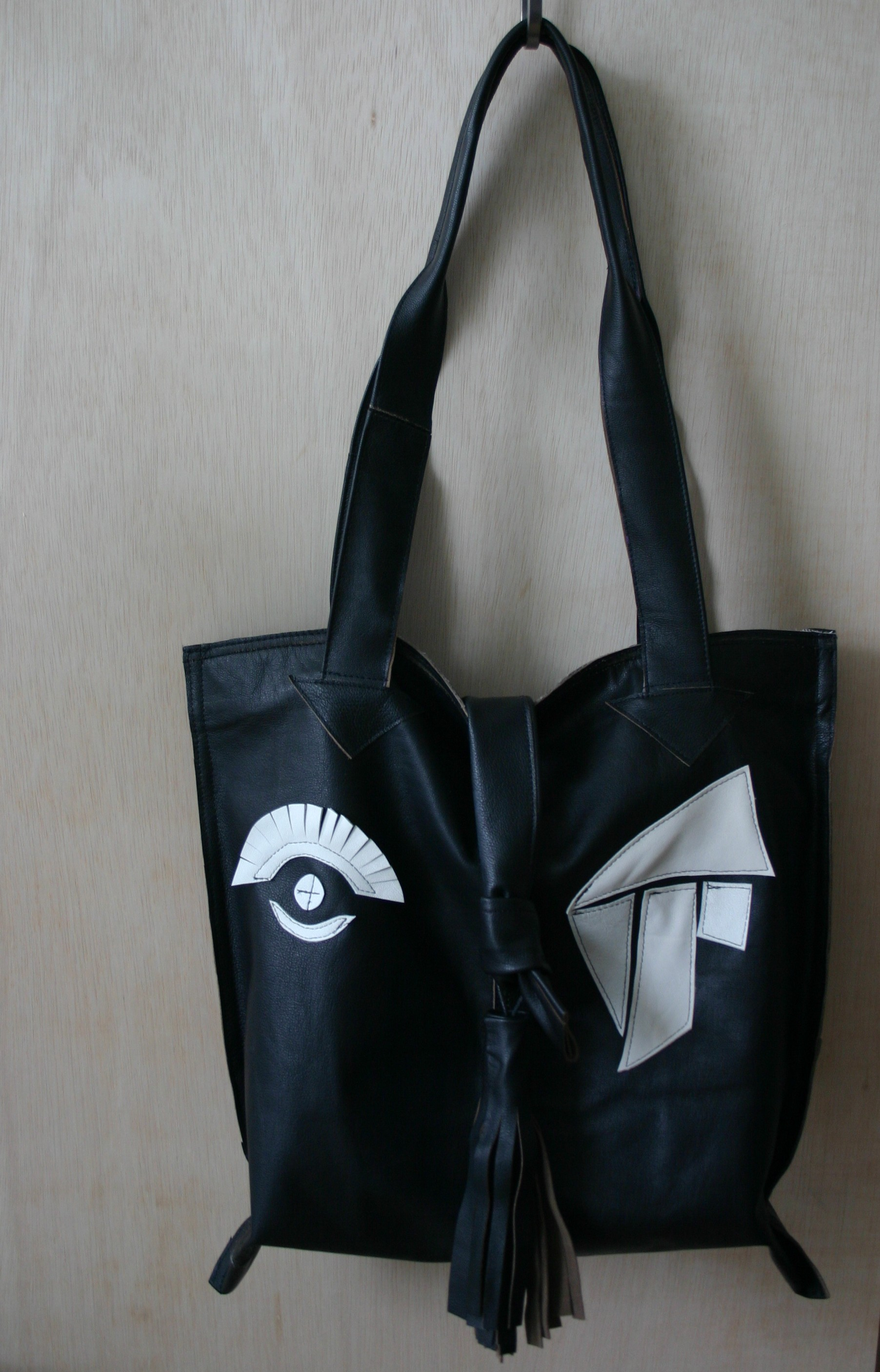 diy leather bag made out of old leather jacket, decorations white leather inspired by abstract art.