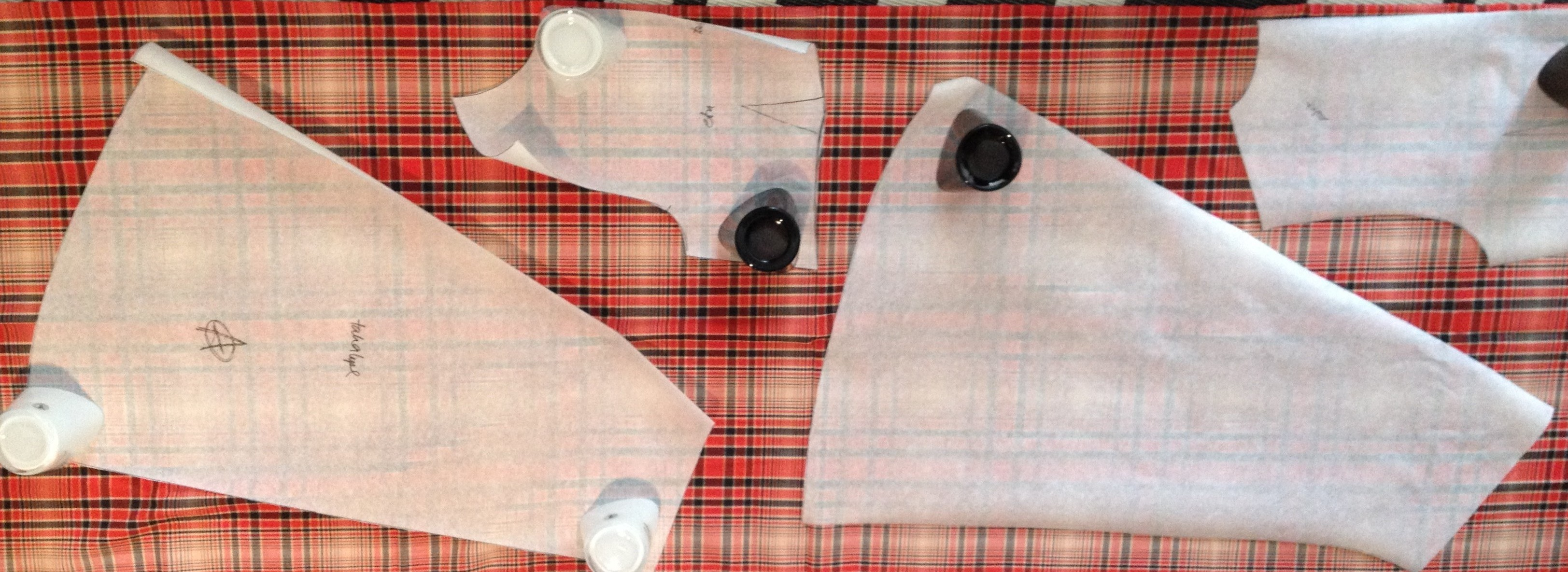laying dress patterns on checkered fabric
