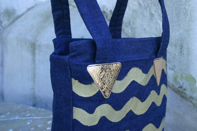 diy denim bag with painted gold colored waves and vintage labels
