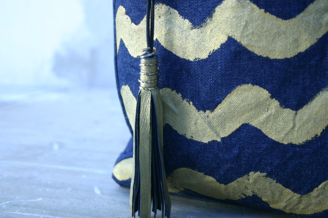 diy denim bag with painted gold colored waves and matching tassel