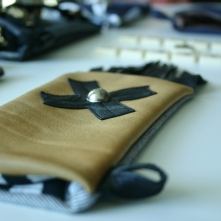 diy leather pouch with swiss cross deco and studs