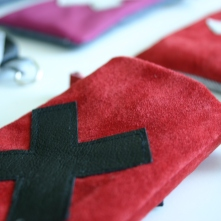 diy red suede pouch with swiss cross deco