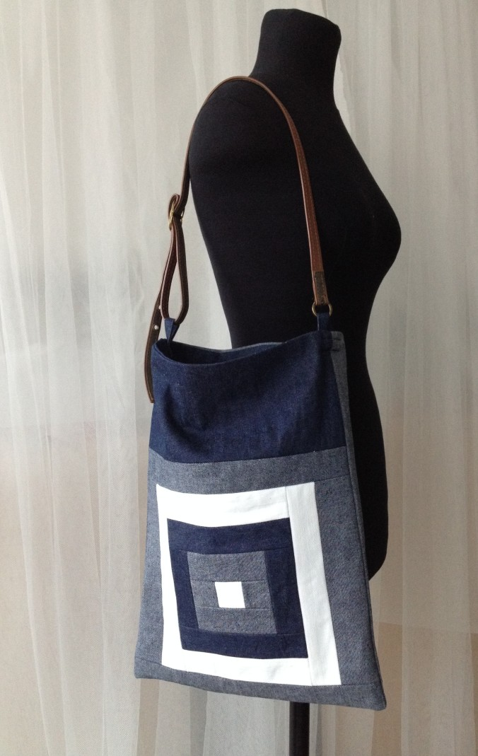 """Kurume kasuri goku masu- five squares"" denim quilt bag on the fitting torso"