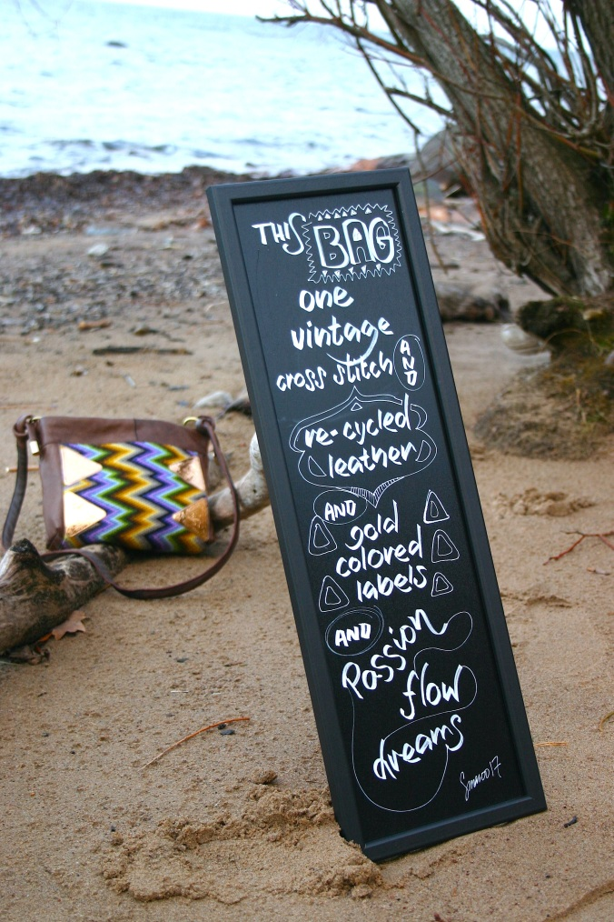 diy bag photoshoot by the waterside with hand lettered board