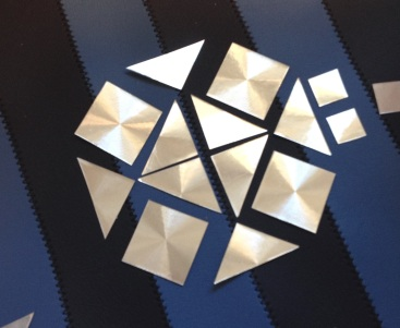 diy cut out small triangles from holographic vinyl